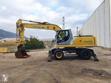 New Holland MH 6.6 excavator pe roti second-hand