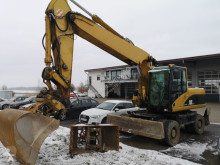 Caterpillar CAT M 322 C excavator pe roti second-hand