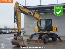 Caterpillar M315 excavator pe roti second-hand