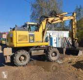 Komatsu PW140-7 excavator pe roti second-hand