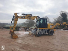 Caterpillar M313 M313D excavator pe roti second-hand