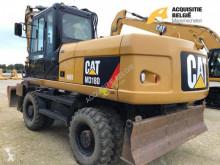 Caterpillar M318D excavator pe roti second-hand