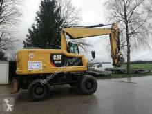 Caterpillar 318 F mit OQ 70/55 neue Reifen used wheel excavator