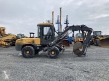 Excavadora Mecalac 12 MTX / 4x4 / excavadora de ruedas usada