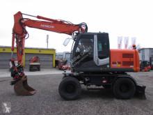 日立 ZX 140 W-3 Rototilt RT40 轮胎式挖掘机 二手