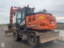 Escavadora de rodas Hitachi ZX 140 W-6 (comes with standard bucket)