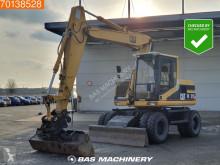 Caterpillar M312 escavadora de rodas usada