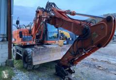 Doosan DX140 W excavator pe roti second-hand