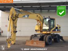 Graafmachine op banden Caterpillar M315