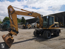 Pelle sur pneus Caterpillar CAT M 312