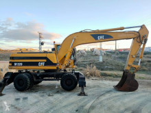 Excavadora Caterpillar 320 M excavadora de ruedas usada