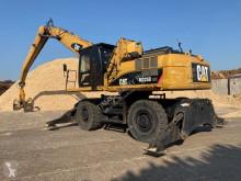 Caterpillar M325DL MH excavadora de ruedas usada
