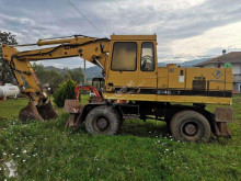 Caterpillar 214 BTF колесен багер втора употреба