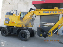 Komatsu PW148-11 escavatore gommato usato