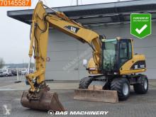 Escavatore gommato Caterpillar M313