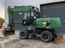 Escavatore gommato Caterpillar M315