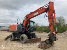 Hitachi ZX140W-3 escavatore gommato usato