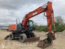Escavadora Hitachi ZX140W-3 escavadora de rodas usada
