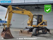 Caterpillar M312 koparka kołowa używana