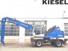 Pelle de manutention Fuchs MHL335 E