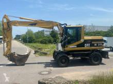 Caterpillar M315 escavatore gommato usato
