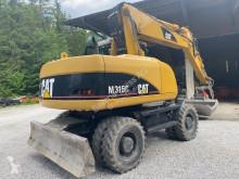 Excavadora Caterpillar CAT M 315 C excavadora de ruedas usada