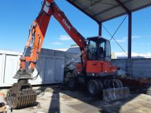 Escavadora de grifa manutenção O&K MH Plus