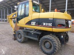 Caterpillar M315 kolová lopata použitý