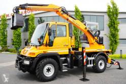 Excavadora Meritano UNIMOG U300, 4×4, plow mounting, hydraulics, excavator + grapple, supports excavadora de ruedas usada