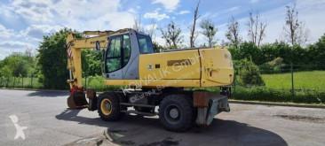 Excavadora New Holland MH 6.6 orig. 1.024 h !!! Pratzen, Scherenverrohr excavadora de ruedas usada