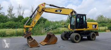 Caterpillar M318D pelle sur pneus occasion
