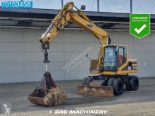 Caterpillar M315 skovel på däck begagnad