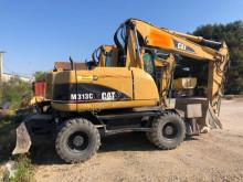 Caterpillar M313C escavatore gommato usato
