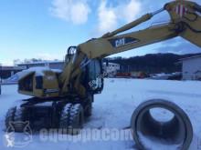 Escavadora de rodas Caterpillar M313C