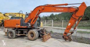 Hitachi ZX180W pelle sur pneus occasion