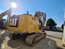 View images Caterpillar 323FL excavator