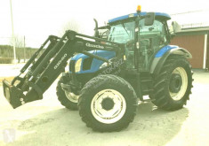 Tractor agrícola tractora antigua New Holland TS110 A 4WD + loader Quicke Q1060