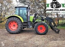 trattore agricolo Claas ARES 657 ATZ - ŁADOWACZ - SILNIK JOHN DEERE 135 KM