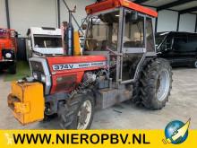 landbouwtractor Massey Ferguson 374V met maai balk airco