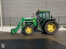 Mezőgazdasági traktor John Deere 6010 tractor met voorlader használt