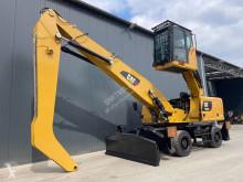 Escavadora de grifa manutenção Caterpillar MH3026
