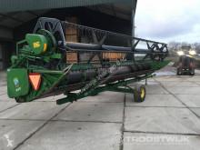 John Deere 825 haymaking