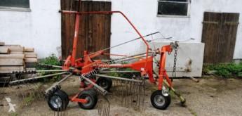 Fella haymaking used