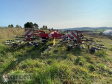 Kosenie lúk a sušenie sena Riadkovač Fella TS 4000 DB