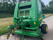 Press med runda balar John Deere 854