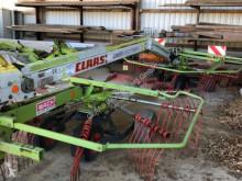 Kosenie lúk a sušenie sena Riadkovač Claas Liner 650 Twin