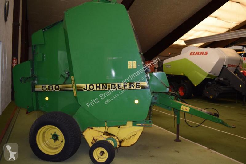 View images John Deere 580 haymaking