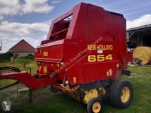 Atadeira de fardos redondos New Holland 654