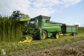 حصاد آلة حصاد ودرس John Deere T660