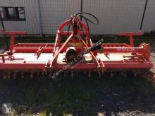 Aperos accionados para trabajo del suelo Rau Grada rotatoria usado